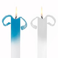 You really can burn a candle from both ends with this two-toned, tapered pair.