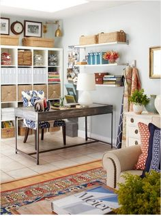 Deep wall shelves over desk in office - storage w/o adding furniture to floor