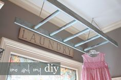 Ladder for hanging clothes in laundry room. Another idea to increase efficiency.