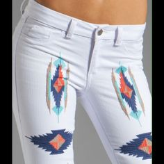 """🎀HP🎀Aztec Tribal Skinny Jeans BRAND NEW Embroidery is in with a bang. White Aztec jeans by """"SOLD Design Lab.""""  AUTHENTIC w/original tags. High quality. Onlly one of each size left. Get your southwest flair.  - Embroidered designs - 5 pocket styling -Superior quality   Royal blue, turquoise, khaki, and coral work with your entire wardrobe. Rise from crotch is 7.5"""". NWT. 20% off bundles. All REASONABLE offers accepted. So...make me an offer😊😊😊 Design Lab Jeans Skinny"""