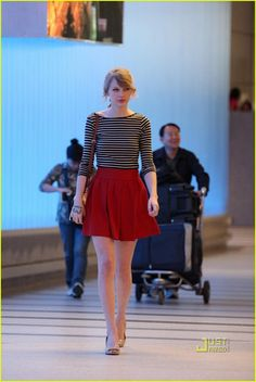 Taylor Swift at LAX. I like her style. It's consistent and she always looks cute. [I want that red skirt].
