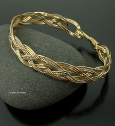 four strand braided gold wire bangle by janraven on etsy httpswww