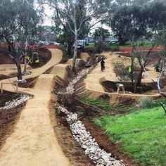 The team is hard at work surfacing the pump track and jumps at Shepherds Hill. It will need a few days to set so please no riding until we open the facility. Won't be long!  #trailscapes #pumptrack #shepherdshill