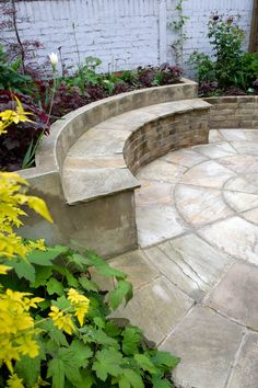 Flooring in the space will be on the form of an Indian sandstone circle measuring 3.6m in diameter. Asection of the outer ring will be elevated to form the a seat fronting a raised planting bed in the bottom left of the space. The existing walls will be rendered and painted and the fence panel mended.  #sandstonecircle #raisedbed #brick