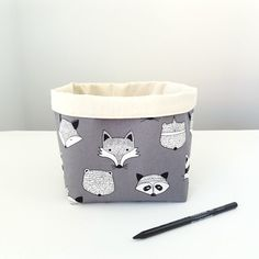 really cute cotton storage basket with badger, bear, fox, and racoon faces, from greylittlemouse on Etsy | Perth, Australia