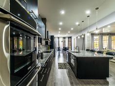 This is so close to what I invision for my future kitchen. Proofing drawer, sink, and dishwasher in the island but large, double oven range behind. Open wall to family room. I want marble counters with an undermount sink. Love the black cabinets. White Quartzite Countertops, Stone Countertops, Kitchen Countertops, Marble Counters, Super White Quartzite, Free Kitchen Design, White Marble Kitchen, Granite Colors, Kitchen Gallery