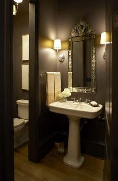 A little dark but I like the grey tone walls & white fixture and the sconces.