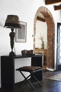 I love the brick archway. want to recreate in our hallway and kitchen