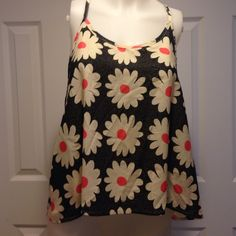 New vintage Havana daisy tank top medium New vintage Havana swing tank top with daisy print.  100% polyester. Retail $52 Vintage Havana Tops Tank Tops