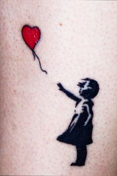 Small Banksy tattoo done by Grey at Deep Blue Tattoo in Grover Beach, CA.