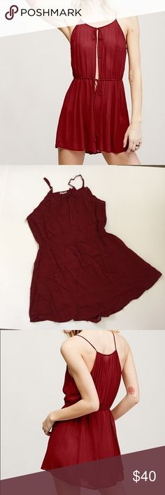 "Free People Liaisons Romper, size small NWT Free People Liaisons Romper in Smoky Red, size small. In a sheer lightweight and crinkly fabric this lounging shorts romper features an adjustable tie at the bust with a plunging neckline. Adjustable tie at the waist. Made from 100% Rayon. Measurements for size Small Bust: 19.5"" = 49.53 cm  