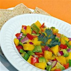 A wonderfully fruity, yet creamy salsa, made with ripe mango, red pepper, red onion and avocado. It's purely addictive. Serve as a side dish or use as a dip. Yummy Appetizers, Appetizer Recipes, Mango Salsa Recipes, Great Recipes, Favorite Recipes, Delicious Recipes, Stop Eating, Original Recipe, Love Food