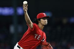 Yu Darvish #11 of the Texas Rangers throws against the Tampa Bay Rays in the first inning at Globe Life Park in Arlington on September 30, 2016 in Arlington, Texas.