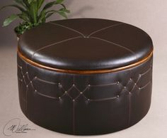 round storage ottoman in brown leather with hidden storage and nail head accents