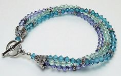 Swarovski crystal triple-strand bracelet can be made in your favorite colors. This sample design uses Chrysolite, Tanzanite & Indicolite. Look for details and materials list on the Idea Page Project #140.