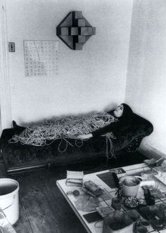 Eva Hesse with a rope sculpture, photograph by Hermann Landshoff c.1969