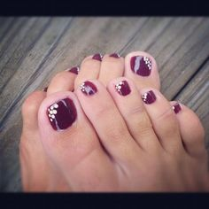 Pretty pedicure: Purple polish with White dots on the inner corner of each toe nail. Love this!