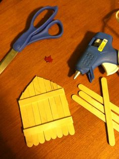 Make your own Gnome/Elf/Fairy Door for your garden tree with popsicle sticks and hot glue. Sticks cut pretty easy with scissors. Then stain or paint and decorate!! :)