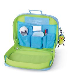 """Tiny travelers will be prepared for long car or plane rides with this TrayKit that keeps all their entertainment together in one place. In its carrying case mode it's perfectly portable thanks to a handle and adjustable backpack straps. Unzip it to reveal the tray that features raised edges to keep toys and crayons contained within. Turn """"Are we there yet?"""" into """"We're there already?"""" when passing time playing with this case."""