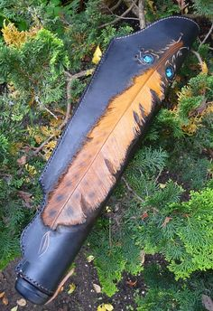 And this one at http://www.etsy.com/listing/112061182/archery-leather-quiver-with-3d-feather