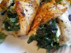 Spinach and Feta Stuffed Chicken: 1/2 cup thawed spinach, squeezed dry 2 cloves garlic minced; 3/4 cup feta; 3 T low-fat cream cheese (optional); 3 T olive oil; 4 boneless skinless chicken breasts.  Preheat oven to 450. Mix spinach, garlic, cream cheese and feta. Cut a slit in each chicken breast and stuff with mixture. Saute in oil to brown (about 4 min. each side). Move to greased oven safe dish and bake until internal temp reaches 165 (about 25 min.)