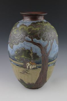 http://sassafrasspottery.com/images/large_tree_vase_with_small_house.jpg
