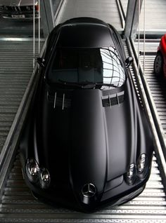 Matte Black Mercedes. Love. The blonde in the pic.