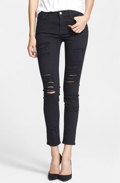 Love these distressed, black skinny jeans. They give off a cool, edgy vibe.