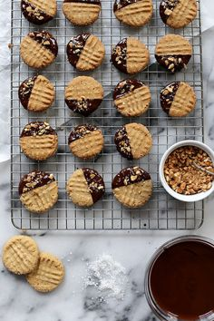 Chocolate-Dipped Crisp Peanut Butter Cookies / Joy the Baker