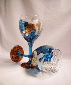 Sea turtle wine glasses hand painted Art on Glass in cobalt blue waters with pewter grey to platinum grey scrolling motion in Art Nouveau