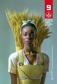 After a day in the fields, Triti Lancaster, 17, graciously offers a bundle of wheat to her fellow citizens of Panem.