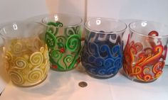 "Now Available! Set of four hurricane glass candle holders decorated with elemental representations made from polymer clay. The candle holders stand approximately 4.5"" tall with a 3"" diameter with a flanged lip. Candles not included. These elemental candle holders look awesome as quarter candles in your temple room or as accents to your living area!"