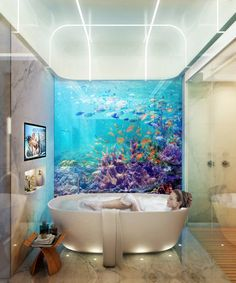#Bath tub next to a window into the sea life in the #underwater Dubai luxury #retreat