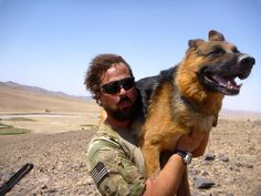 This amazing soldier carried his service dog down a mountain because it was 117 degrees & the rocks were burning his feet- AWESOME!!!!