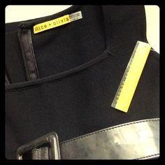 I just added this to my closet on Poshmark: NWT Alice + Olivia black bandage style dress. Price: $109 Size: M