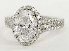 Sparkling and elegant, this diamond engagement ring features pavé-set diamonds crafted in a split-shank design of enduring platinum. Setting includes 1/2 carat total diamond weight.