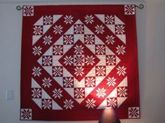 "45 and Life to Go in reds, Lisa B. This measures 55x55 and the squares in the middle of each star are 1/2""."