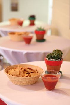 Cactus Centerpieces potted in terra-cotta - Spray painted with Red on top and Green on the bottom for a Mexican Themed Fiesta/Party. Used high gloss paint so it would look shinny. Pair with a crisp white linen, stemless martini glass and chip basket!