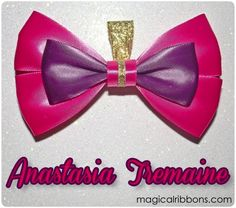 Show off how eligible you are in this bow inspired by Cinderella's stepsister. Handmade with dark pink and violet wine ribbon and trimmed with gold. Complete this stepsister set with the Drizella Tremaine bow.