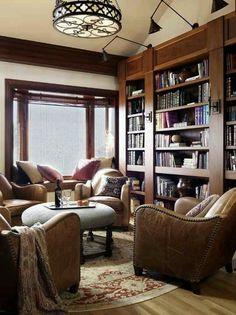 Love idea of entertainment center bookshelves and tv with a round cozy sitting nook.. in home office!