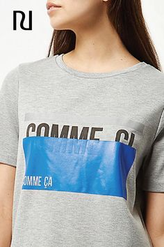 """Some days are just okay and call for a shirt to fit the mood. This women's """"comme ci, comme ça"""" shirt is a playful way to tell the world how you're feeling. Pick up the french-inspired tee shirt now for just £24."""