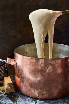 NYT Cooking: Somewhere between buttery mashed potatoes and pure melted cheese lies aligot, the comforting, cheese-enhanced mashed-potato dish from central France. Cheese Mashed Potatoes, Creamed Potatoes, Aligot Potatoes, Cheese Recipes, Potato Recipes, Dishes Recipes, Savoury Recipes, Mushrooms, Cheese