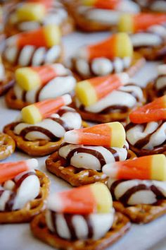 Halloween Pretzel/Chocolate Snack: 350 deg. oven; put waffle square pretzels on parchment lined baking sheet; top w/ unwrapped Hug or Kiss; bake ~3min; press candy corn into each soft chocolate; cool.