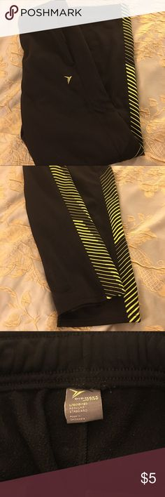 Old Navy boy's track pants Black boy's track pants with green detail on legs. Size 10-12. $5 each or $10 for 3. Bottoms Sweatpants & Joggers