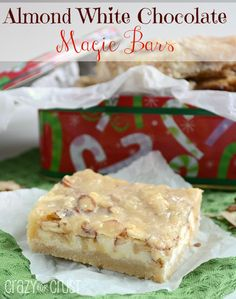 Almond White Chocolate Magic Bars by www.crazyforcrust.com | An almond paste infused crust and topping with a white chocolate center!