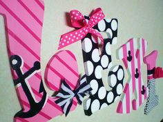 Hand Painted Personalized Wooden Letters Pink, Navy, and White Nautical Theme for Nursery, Bedroom, or Party. $11.00, via Etsy.