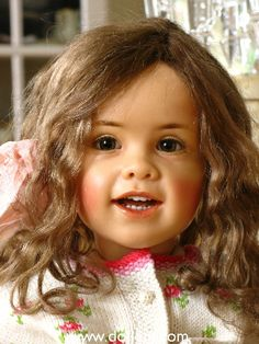 Charlotte, One of a kind, Cernit (Modelene) with cloth body.  Brown glass eyes and brown human hair hand dyed by Sissel.