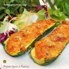 Zucchine ripiene al tonno con asiago, ricetta molto facile. Ottimo l'accostamento degli ingredienti, un piatto unico sostanzioso da gustare tiepido.