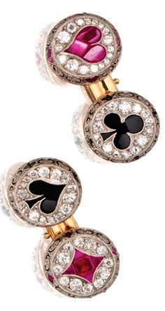 PLATINUM, GOLD, DIAMOND, RUBY AND ONYX DRESS SET Including a pair of cufflinks and four studs, the terminals designed as various card suits, set with old European-cut and single-cut diamonds weighing approximately 2.50 carats, and calibré-cut rubies and onyxes.  With fitted box.