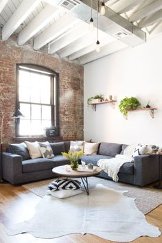A young couple's Williamsburg industrial apartment. Still cozy, though, still cozy. HomePolish The post Dreamy industrial Brooklyn home appeared first on Daily Dream Decor. decor apartment industrial Dreamy industrial Brooklyn home (Daily Dream Decor) Home Living Room, Apartment Living, Living Room Designs, Living Room Decor, Apartment Interior, Cozy Apartment, Studio Apartment, Living Room Brick Wall, Cow Hide Rug Living Room